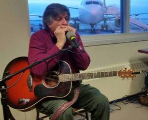 At Yellowknife airport, 2016. Best gig ever. Harmonica solo.