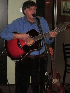 Jonathan Churcher - host, Javaroma Open Mic, Yellowknife. Photo: Marino Carebeer